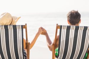 New-Era-Debt-Solutions-Couple-Relaxing-On-Beach