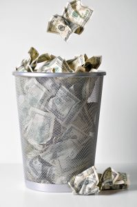 Money in a trash can.