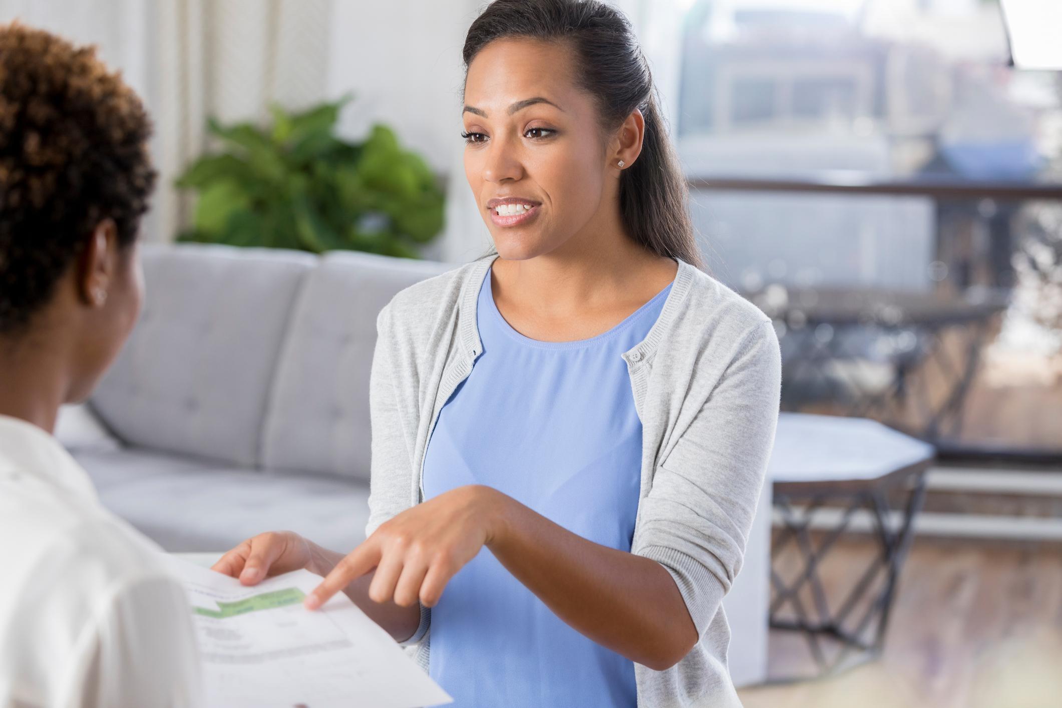 Businesswomen meet to discuss financial statement