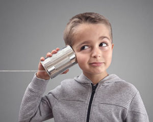 Kid using tin can phone