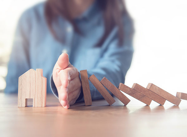 Woman stopping domino effect