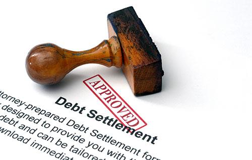 debt settlement qualification