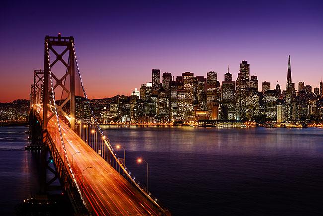 San Francisco skyline behind Golden Gate Bridge