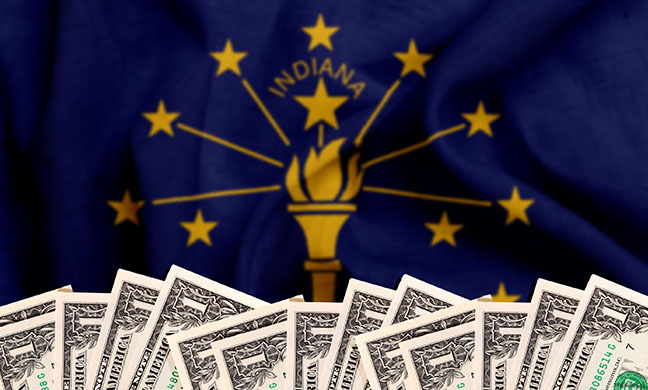 Row of dollar bills in front of Indiana state flag