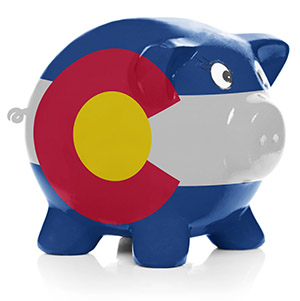 Piggy bank painted with Colorado state flag