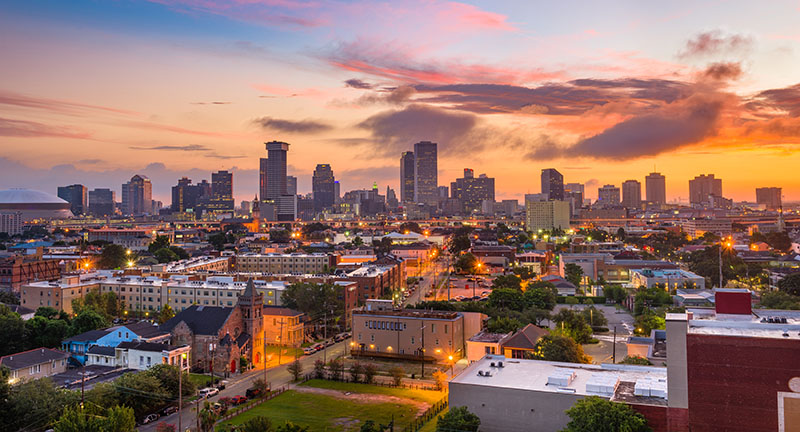 New Orleans city skyline at sunset