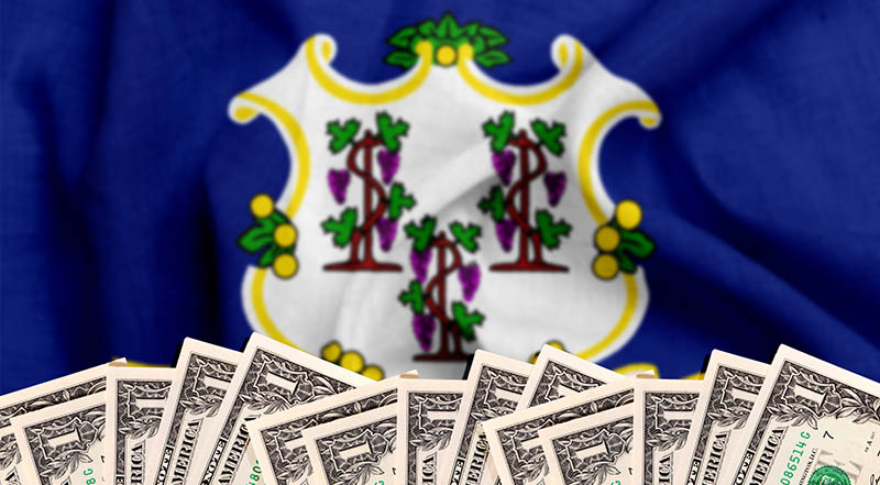 1 dollar bills in front of Connecticut state flag
