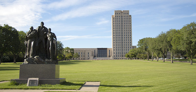 Pioneer Family Statute in front of the North Dakota state capitol building in Bismarck