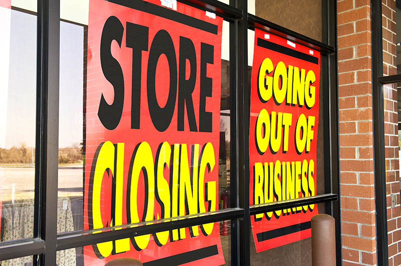 Going out of business sign on store window